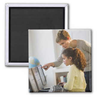 Teacher helping student in computer lab square magnet