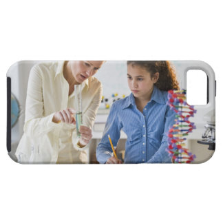 Teacher helping student in science lab case for the iPhone 5