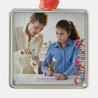 Teacher helping student in science lab christmas ornament