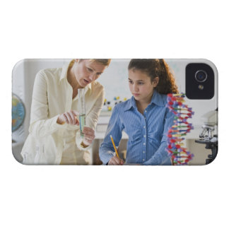 Teacher helping student in science lab iPhone 4 covers