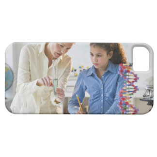 Teacher helping student in science lab iPhone 5 cover