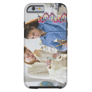 Teacher helping student in science lab tough iPhone 6 case