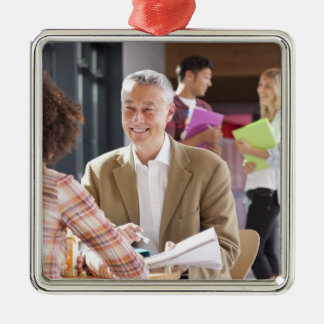Teacher helping students studying in school christmas ornament