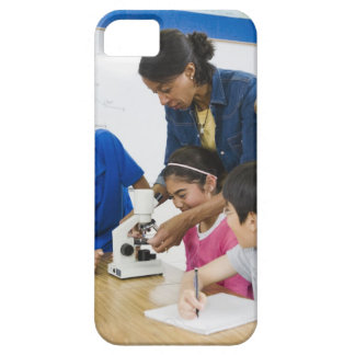 Teacher helping students use microscope in case for the iPhone 5
