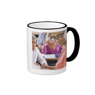 Teacher in classroom mugs