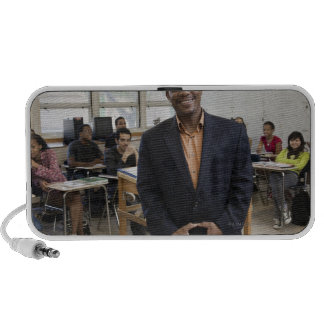 Teacher in classroom with students travelling speaker