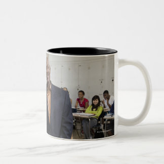 Teacher in classroom with students Two-Tone coffee mug