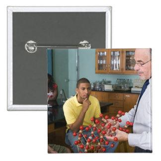 Teacher instructing students 15 cm square badge
