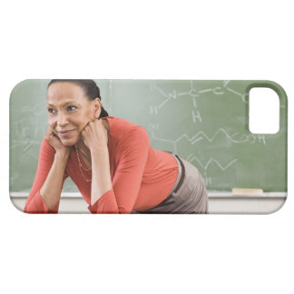 Teacher leaning on desk by chalkboard case for the iPhone 5