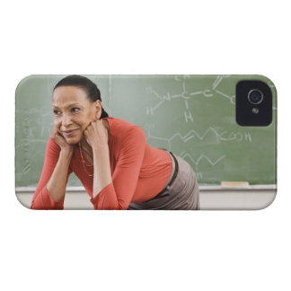 Teacher leaning on desk by chalkboard iPhone 4 covers