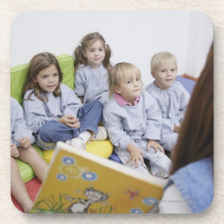 Teacher reading to students coasters