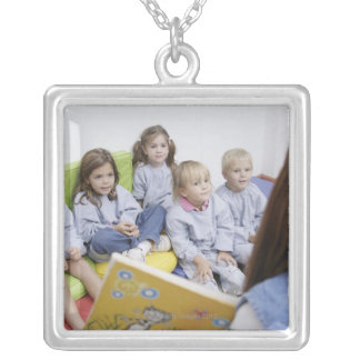 Teacher reading to students silver plated necklace