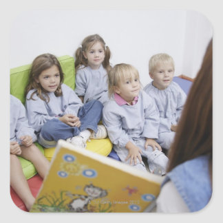 Teacher reading to students square sticker