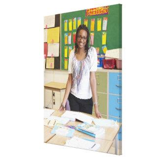 Teacher standing in classroom canvas print