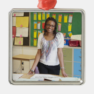 Teacher standing in classroom Silver-Colored square decoration