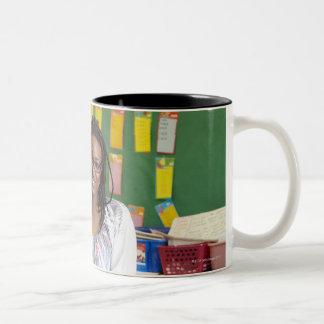 Teacher standing in classroom Two-Tone coffee mug