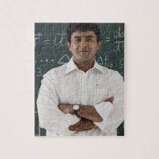 teacher standing in front of chalkboard, arms jigsaw puzzle
