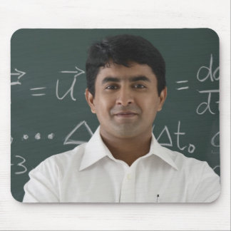 teacher standing in front of chalkboard, arms mouse mat
