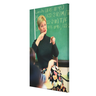 Teacher talking and pointing at front of canvas print