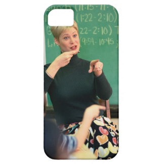 Teacher talking and pointing at front of case for the iPhone 5