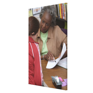 Teacher talking to student canvas print