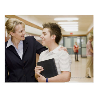 Teacher talking to student, hand on his shoulder post cards