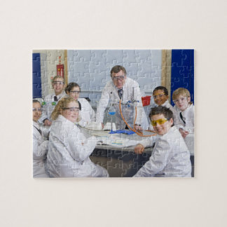 Teacher with his science class, all pupils puzzle