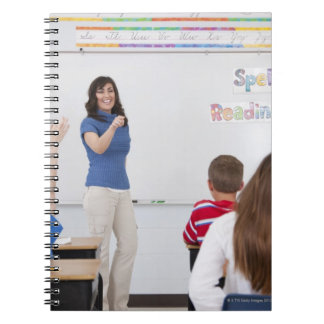 Teacher with students notebooks