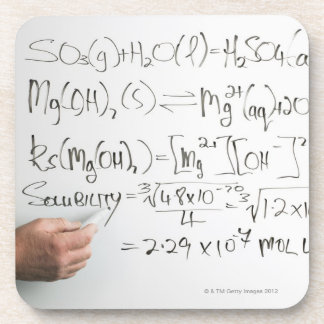 Teacher writing chemical formulae on white board coaster