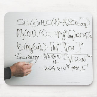 Teacher writing chemical formulae on white board mouse pad
