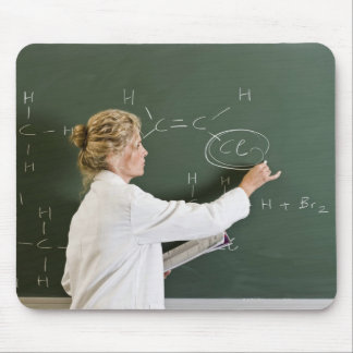 Teacher writing on chalkboard mouse pad