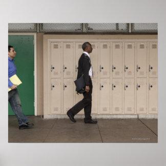 Teachers walking in school corridor poster