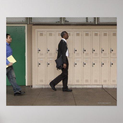 Teachers walking in school corridor print