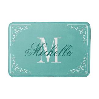 Teal blue bath mat with elegant name monogram