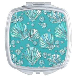 Teal, seafoam sea shells, turquoise background vanity mirror