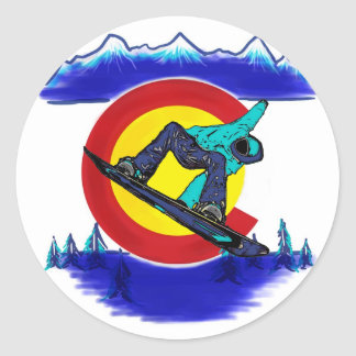 Teal snowboarder Colorado flag symbol sticker