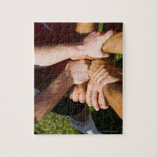 Team with arms-in jigsaw puzzle