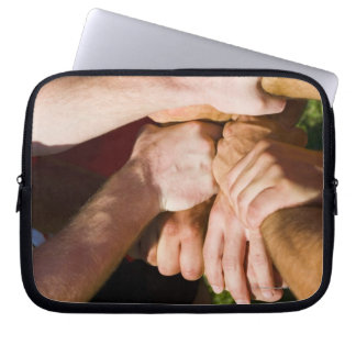 Team with arms-in laptop sleeve
