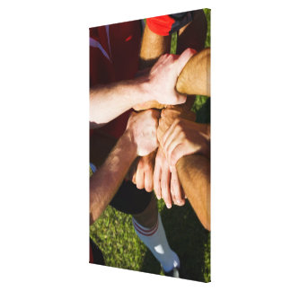 Team with arms-in stretched canvas print