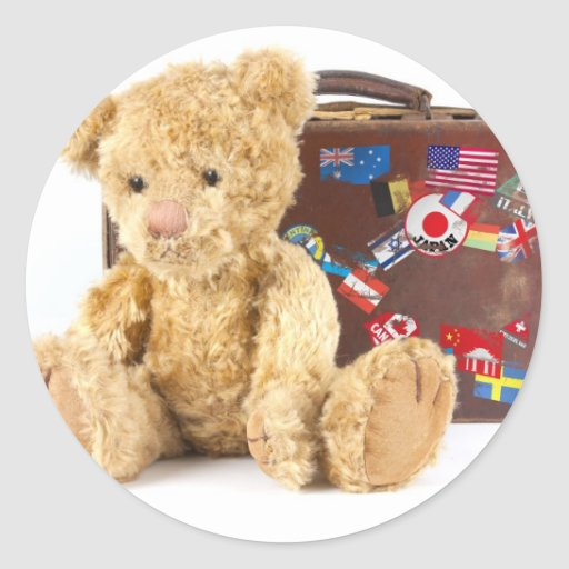 teddy bear and vintage old suitcase with world sti stickers
