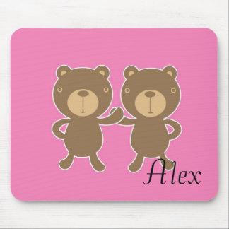 Teddy bear on plain pink background mousepads
