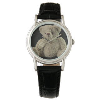 Teddy shows watch