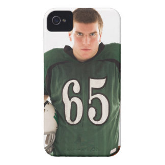 Teen football player holding helmet, portrait Case-Mate iPhone 4 cases