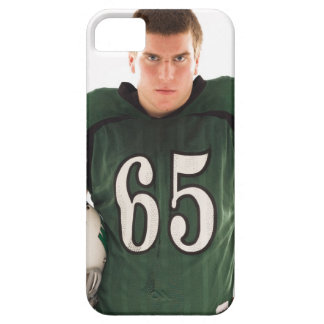 Teen football player holding helmet, portrait iPhone 5 covers