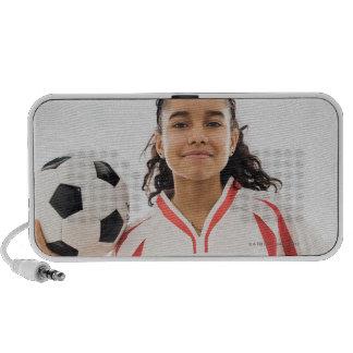 Teen girl holding soccer ball in hand, portrait portable speakers