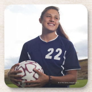 teen girl soccer player holding soccer ball beverage coasters