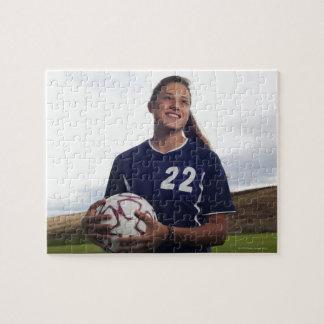 teen girl soccer player holding soccer ball jigsaw puzzle