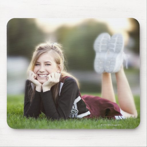 Teen relaxing on grass mouse pads