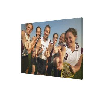 Teenage (16-17) lacrosse team signalling number canvas print