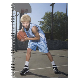 Teenage boy on basketball court 2 notebook